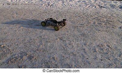 RC buggy car on snowy road