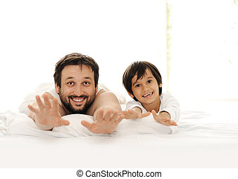 Father and son in bed, happy time