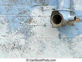 grunge wall rain pipe overpainted in blue and white