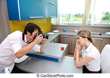 Photo session in kitchen with professional photographer and model