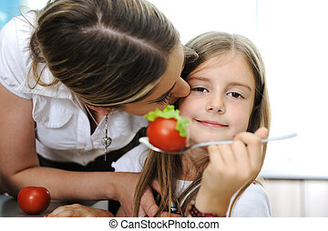 Kissing, Mother and daughter cooking, love and work together