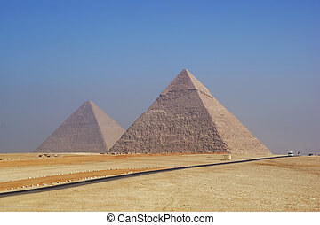 Two Pyramids of Giza at foggy morning