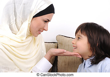 Muslim mother and her son, love and care