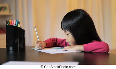 Girl Coloring A Pretty Picture - A cute little 5 year old...
