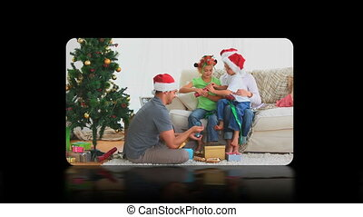 Hand activating christmas videos on touch screen against a...