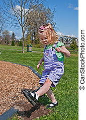 Toddler Girl is Stomping Dirt - This Caucasian 3 year old...