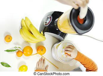 Blender making fruit juice in kitchen