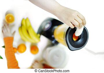Blender making fruit juice at home
