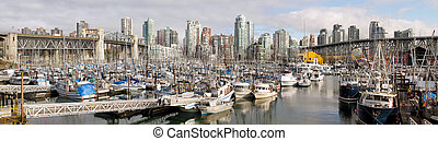 Vancouver BC City Skyline with Burrard and Granville Bridges...