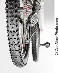 Bicycle with winter tyre - Knobby winter tire with spikes on...
