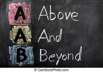Acronym of AAB for Above and Beyond written in chalk on a...