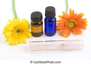 Essential oil and gerbera daisy on white background