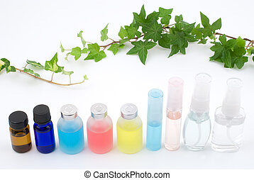 Line of colorful essential oil with ivy on white background