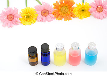Colorful essential oil and flowers - Colorful essential oil...