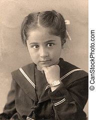 Old photo. - Vintage studio close up portrait of a child,...