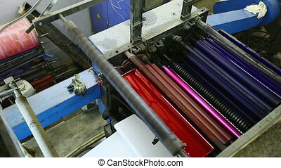 top view on print shop machine detail with color