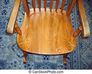Rocking chair - Rocking chair on a persian carpet indoors