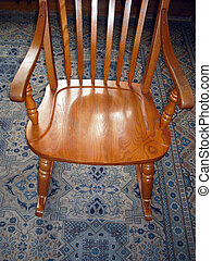 Rocking chair. - Rocking chair on a persian carpet indoors.