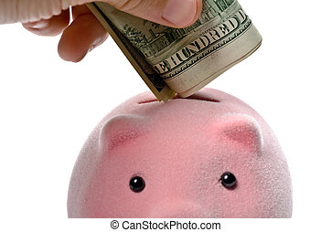 Piggy bank and dollars - Male hand putting dollars into a...