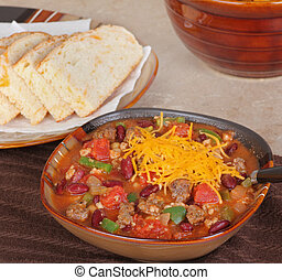 Chili with Cheese - Bowl of chili with beans and chedar...