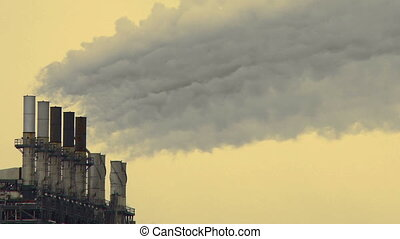 Petrochemical industry smoke stacks - Smoke stacks from a...