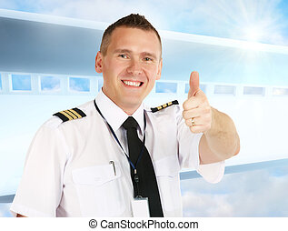 Airline pilot thumb up - Cheerful airline pilot wearing...