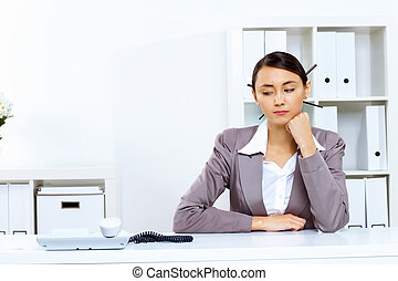 Young woman with a phone in office - Young woman in business...