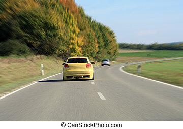 silver and yellow car driving on the road