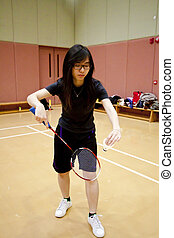 Asian woman playing badminton