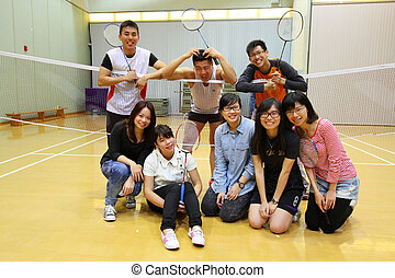 Asian friends playing badminton