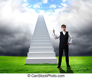 Businessman in suit standing near stairs