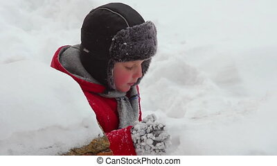 Boy play in snow