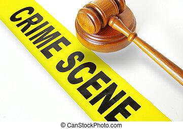 judges gavel and yellow crime scene tape