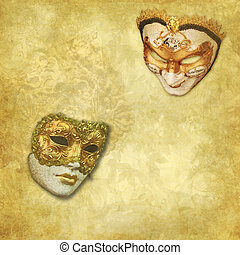 two Venetian masks on a rich golden textured background