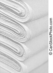 Stack of new white towels close-up - background - A stack of...