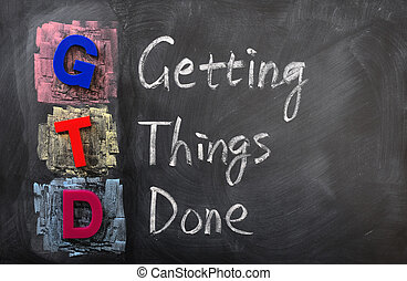 Acronym of GTD for Getting Things Done written in chalk on a...