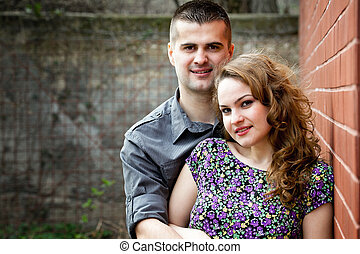 Portrait of young couple in love - Young couple in love -...