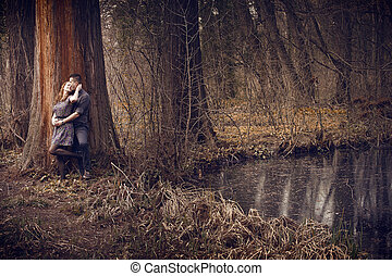 Young couple hugging with passion outdoor