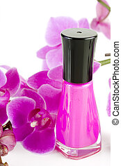 Nail Polish - Image of nail polish with orchid in background