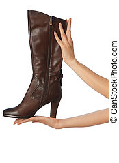 brown footwear - brown female boots in hands at the...