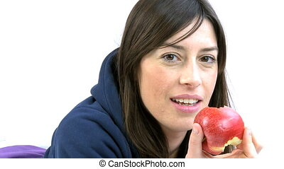 Woman smiling eating apple
