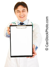 Smiling medical doctor holding blank clipboard isolated on white