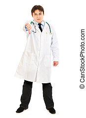 Full length portrait of displeased medical doctor showing thumbs down gesture isolated on white