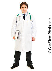 Full length portrait of smiling medical doctor holding clipboard isolated on white