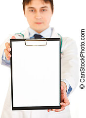 Medical doctor holding blank clipboard in hand isolated on white. Close-up.