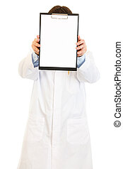 Medical doctor holding blank clipboard in front of her face isolated on white