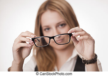 Concept: poor eyesight - Girl holding glasses, selective...