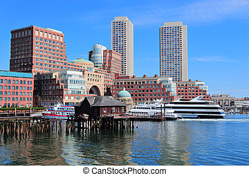 Boston waterfront with skyscrapers and boat in the morning