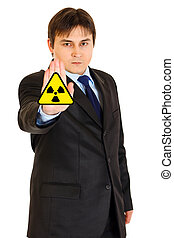 concept-radiation hazard! Confident modern businessman...