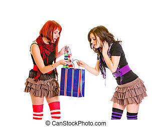Curious charming girls looking at shopping bag isolated on...